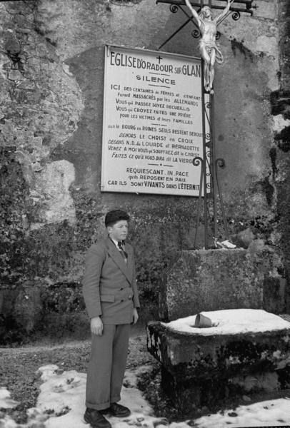Roger Godfrin standing outside the church in Oradour