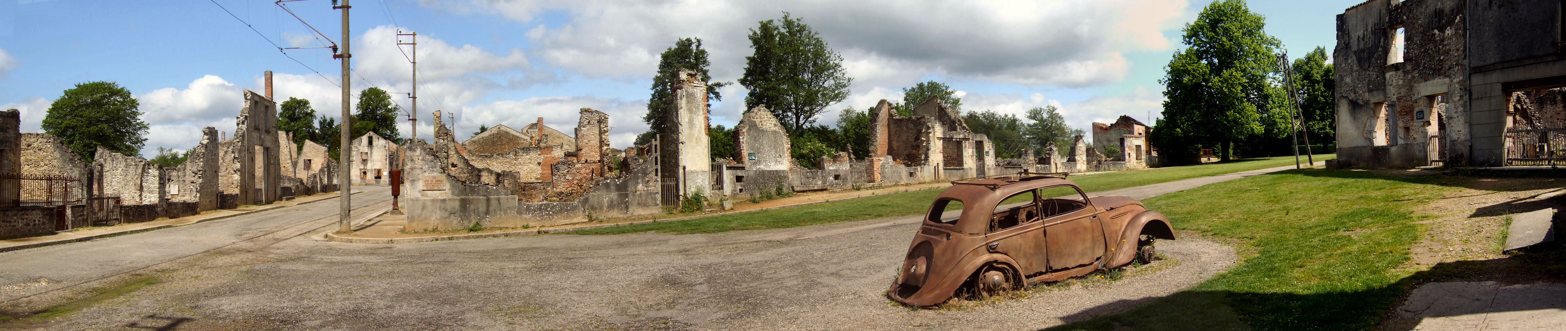 The Champ de Foire and the doctor's car at Oradour-sur-Glane looking north.